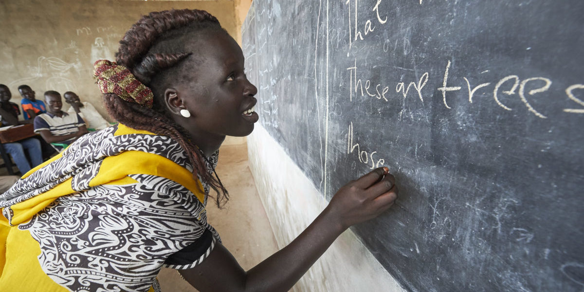 A woman writes on a blackboard in an English class in the JRS Arrupe Learning Center, in Bunj, South Sudan.
