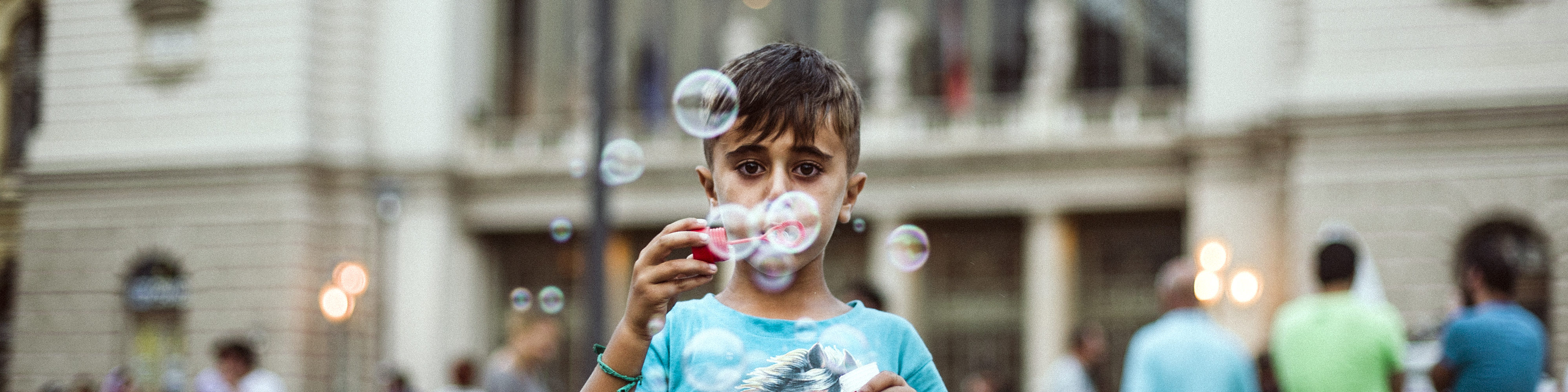 Syrian refugee playing with soap bubbles in Hungary.